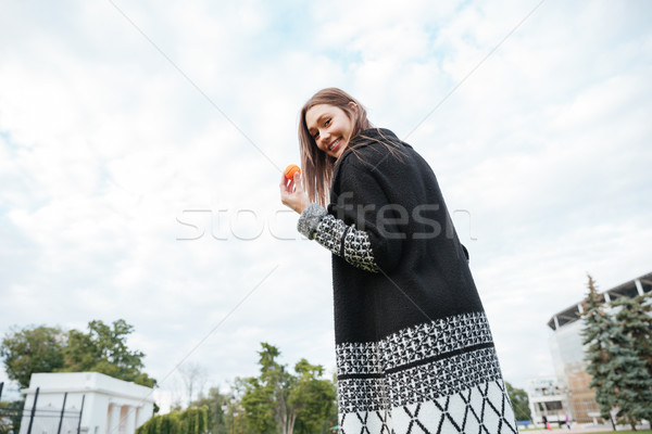 Back view of happy woman with small ball Stock photo © deandrobot