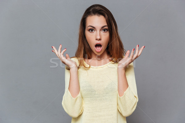 Shocked terrified woman holding hands at her face Stock photo © deandrobot