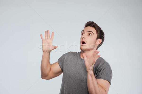 Bać młody człowiek biały Zdjęcia stock © deandrobot