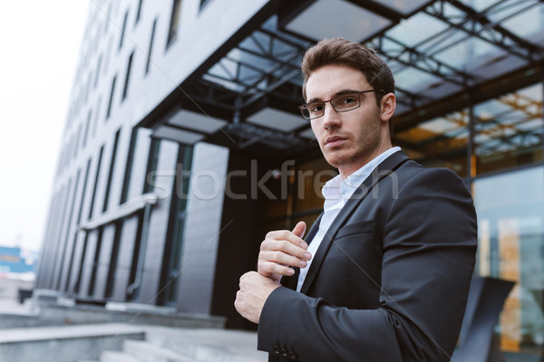 From below image of Business man in glasses standing sideways Stock photo © deandrobot