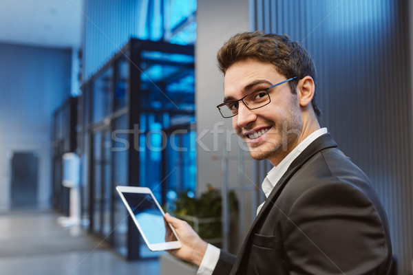 Back view of Smiling Business man with laptop computer Stock photo © deandrobot