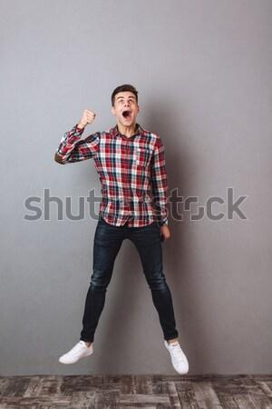 Zdjęcia stock: Wesoły · podniecony · młody · człowiek · okulary