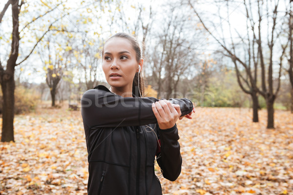 Young female runner in warm clothes make sport exercise Stock photo © deandrobot