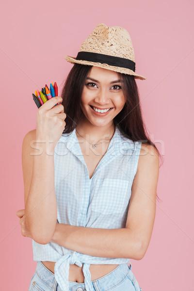 Fiatal hölgy tart viasz zsírkréták kép Stock fotó © deandrobot