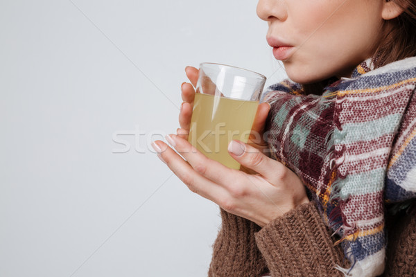Cropped photo of sick young woman drinking medicine. Stock photo © deandrobot