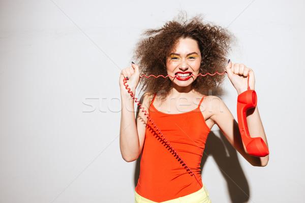 Olağandışı model telefon kordon bakıyor Stok fotoğraf © deandrobot