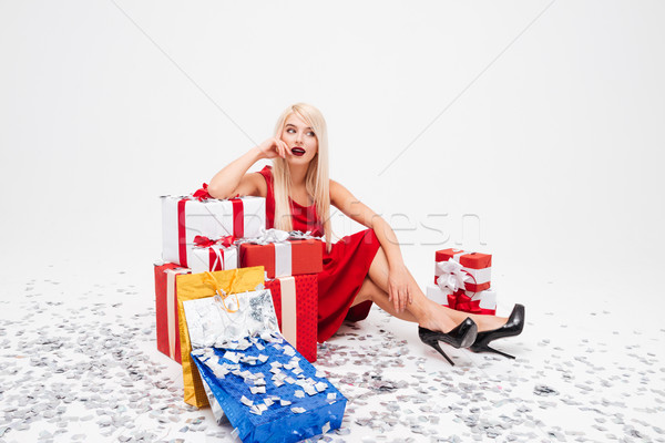 Woman sitting on the floor with heap of xmas presents Stock photo © deandrobot