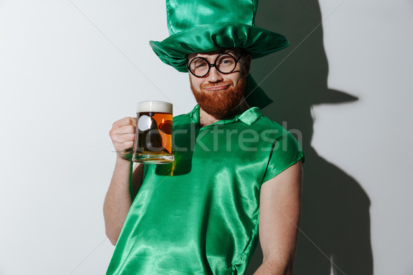 Drunk man in st.patriks costume holding beer Stock photo © deandrobot