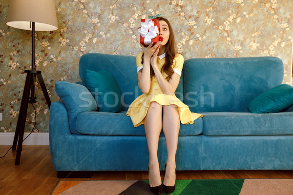Young woman covering her eye with gift Stock photo © deandrobot