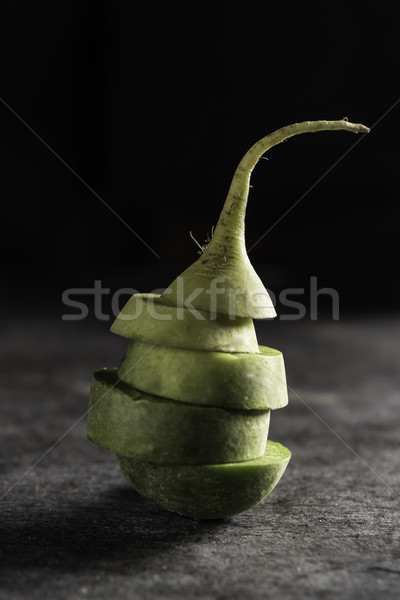 The cut radish over dark background Stock photo © deandrobot
