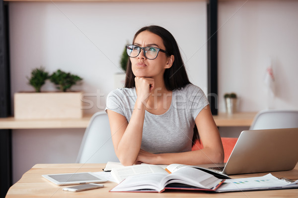 Concentrated woman indoors working with documents. Stock photo © deandrobot