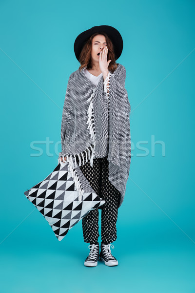 Tired young woman in hat yawning and holding pillow Stock photo © deandrobot