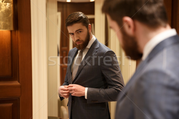 View from back of handsome  man looking at the mirror Stock photo © deandrobot