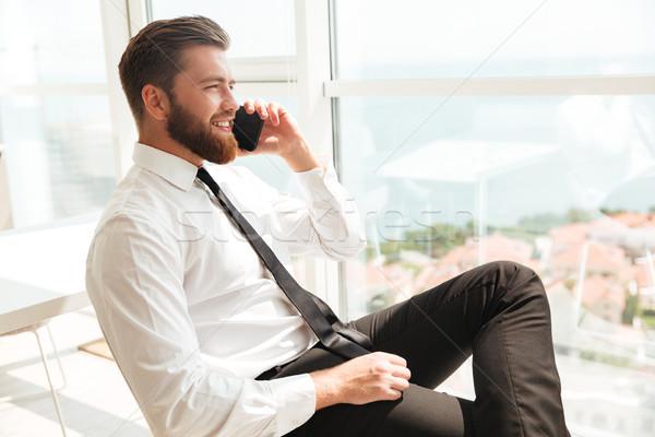 Oldalnézet szakállas férfi üzlet ruházat olvas Stock fotó © deandrobot