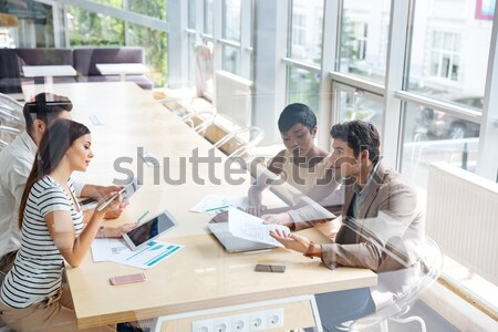 Cheerful young colleagues in office coworking make selfie Stock photo © deandrobot