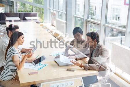 Alegre jóvenes colegas oficina foto Foto stock © deandrobot