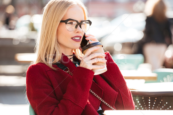 Amazing young caucasian woman talking by phone drinking coffee Stock photo © deandrobot