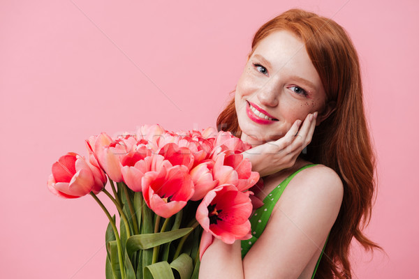 Young woman holding tulips Stock photo © deandrobot