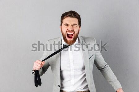 Mérges sikít szőke nő üzletasszony tart kar Stock fotó © deandrobot
