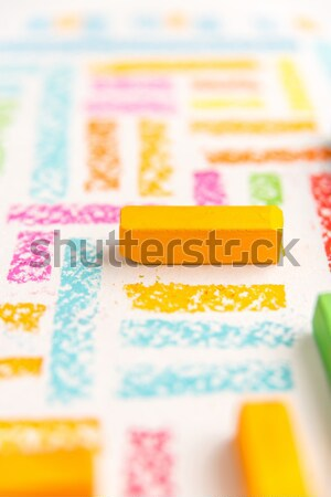 Stock photo: Close up photo of pastels chalks on colorful background
