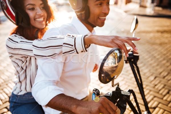 Vista lateral satisfeito africano casal motocicleta moderno Foto stock © deandrobot