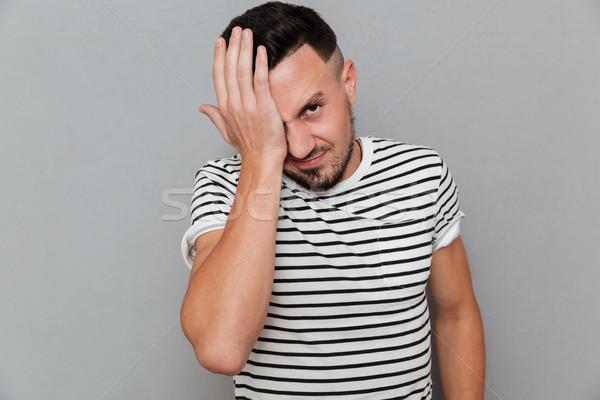 Portret młodych przypadkowy człowiek cierpienie migrena Zdjęcia stock © deandrobot
