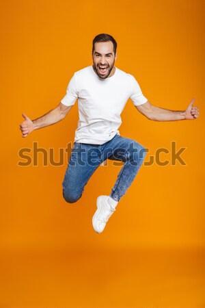 Teljes alakos portré vicces lezser férfi ugrik Stock fotó © deandrobot