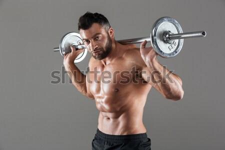 Fotó izzadt testépítő emel súlyzó izolált Stock fotó © deandrobot