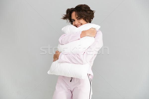 Portret młoda dziewczyna piżama poduszkę patrząc Zdjęcia stock © deandrobot