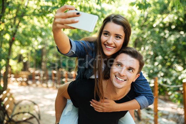 Portrait of a young happy couple in love Stock photo © deandrobot