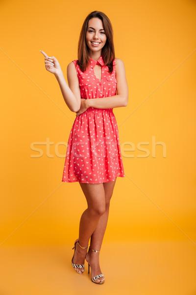 Obraz szczęśliwy brunetka kobieta sukienka Zdjęcia stock © deandrobot