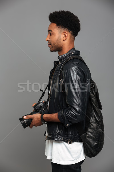 Side view photo of handsome stylish african man with backpack ho Stock photo © deandrobot