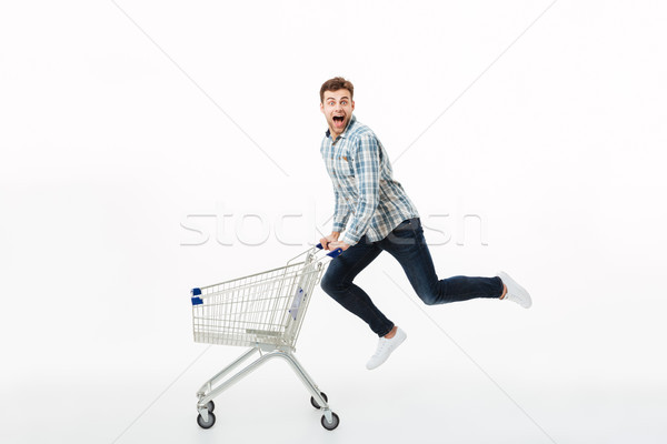 Full length portrait of a cheerful man jumping Stock photo © deandrobot