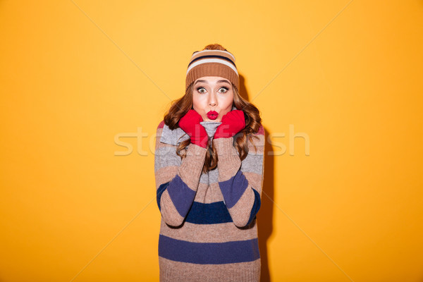 Portrait of a frozen girl dressed in winter clothes Stock photo © deandrobot