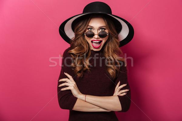 Genç şaşırtıcı bayan şapka güneş gözlüğü Stok fotoğraf © deandrobot