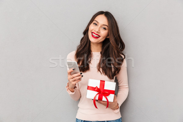 Picture of pretty brunette female with brown hair winning new si Stock photo © deandrobot