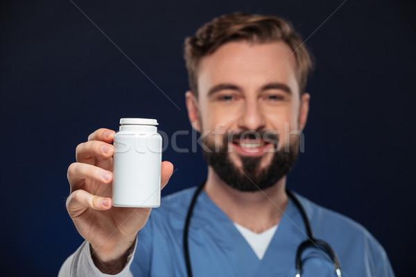 Portrait of a friendly male doctor Stock photo © deandrobot