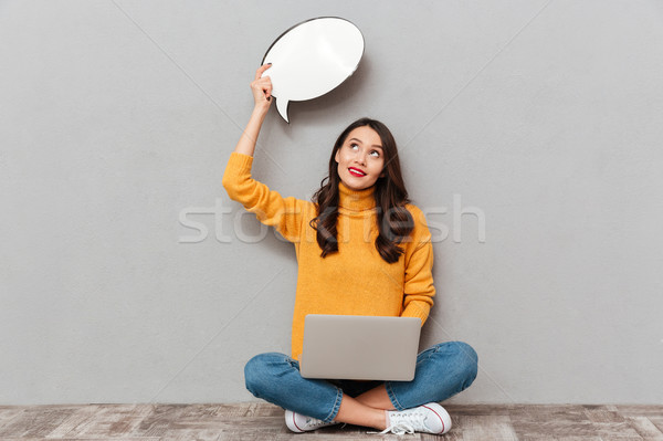 Pensive brunette woman in sweater sitting on the floor Stock photo © deandrobot