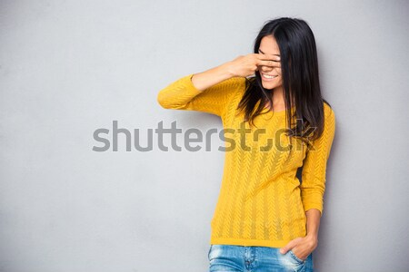 Image timide femme chandail toucher Photo stock © deandrobot