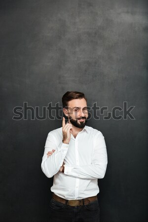 Brunette businessman posing on camera with tricky happy look, po Stock photo © deandrobot