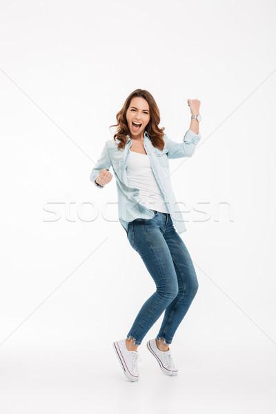 Animado belo mulher jovem foto isolado branco Foto stock © deandrobot
