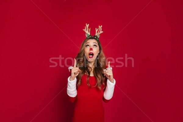Megrémült fiatal nő visel karácsony szarvas jelmez Stock fotó © deandrobot