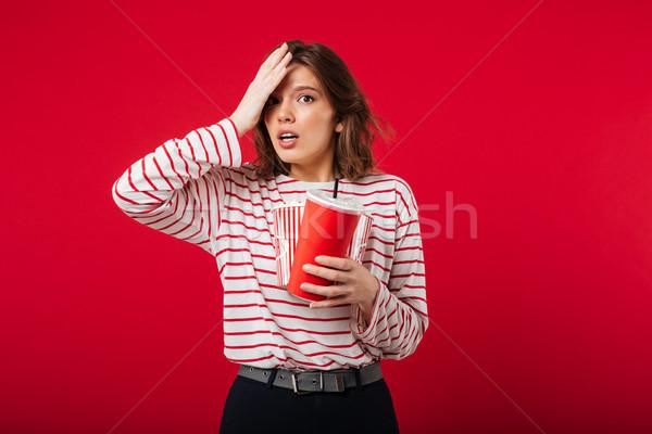 Retrato confuso mulher pipoca plástico Foto stock © deandrobot