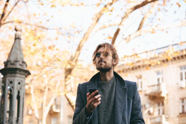 Portre genç sakallı adam güneş gözlüğü kat Stok fotoğraf © deandrobot