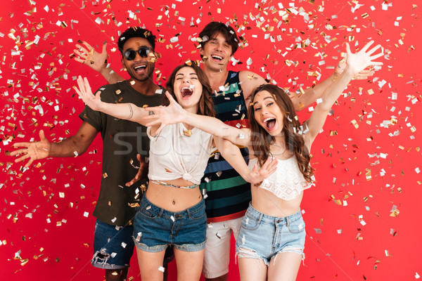 Portrait of a happy cheerful group of multiracial friends Stock photo © deandrobot