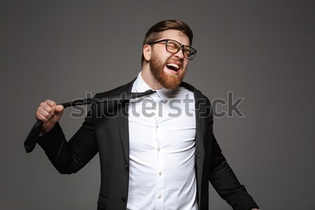 Portrait of a mad young businessman Stock photo © deandrobot