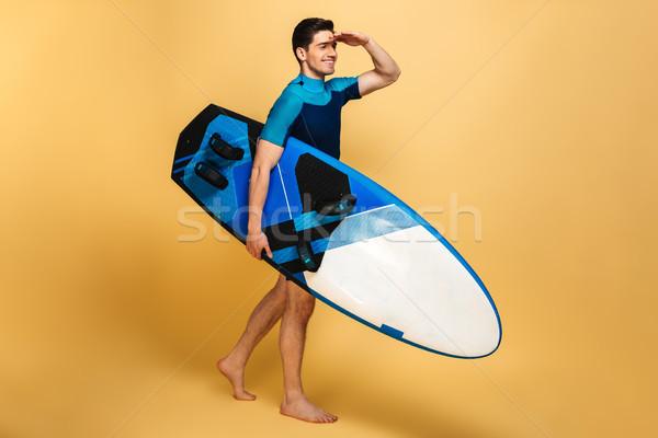 возбужденный молодым человеком купальник глядя изображение Сток-фото © deandrobot