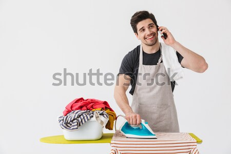 Portrait of a smiling young half naked sportsman resting Stock photo © deandrobot