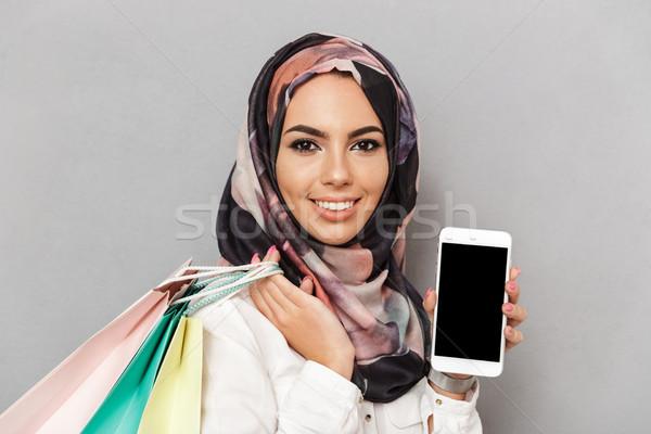 Portrait of a happy young arabian woman Stock photo © deandrobot