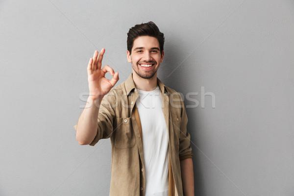 Portre mutlu genç gündelik adam Stok fotoğraf © deandrobot